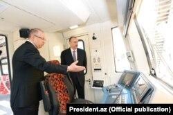 Prezident İlham Əliyev yeni qatarlara baxır