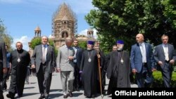 Armenia - Prince Charles (C) visits the Echmiadzin headquarters of the Armenian Apostolic Church, 30May2013.
