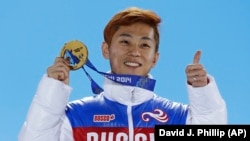 Men's 1,000-meter short-track speed-skating gold medalist Viktor Ahn of Russia holds his medal during the medals ceremony at the Winter Olympics in Sochi in February 2014.