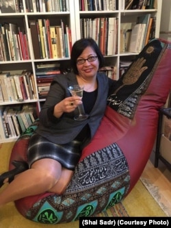 Rights activist Shadi Sadr sits on a chair featuring Islamic motifs that was created by Forouhar.