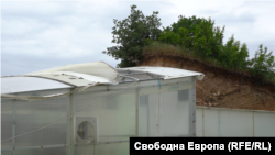 A broken section of the shelter that is supposed to protect the Karanovo chariot from the elements