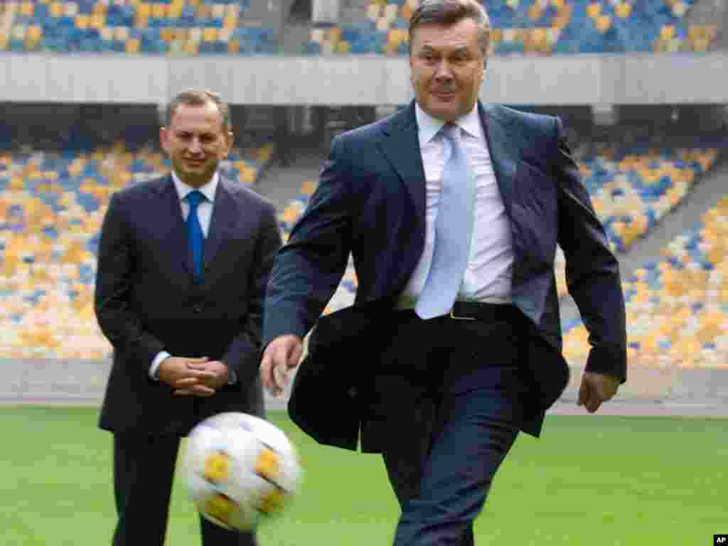 Ukrainian President Viktor Yanukovych kicks a ball during a visit to the Olympiyskiy national stadium, Kyiv, on September 23. The stadium will be the venue for the final of the Euro 2012 soccer tournament. (Photo taken by Mykhailo Markiv for AP)