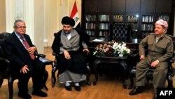 Iraqi President Jalal Talabani (left),Shi'ite cleric Moqtada al-Sadr (center), and Iraqi Kurdish leader Massud Barzani (right) at a crisis summit in Irbil on April 27.