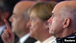 Chancellor Angela Merkel and Greek Prime Minister George Papandreou in Berlin today
