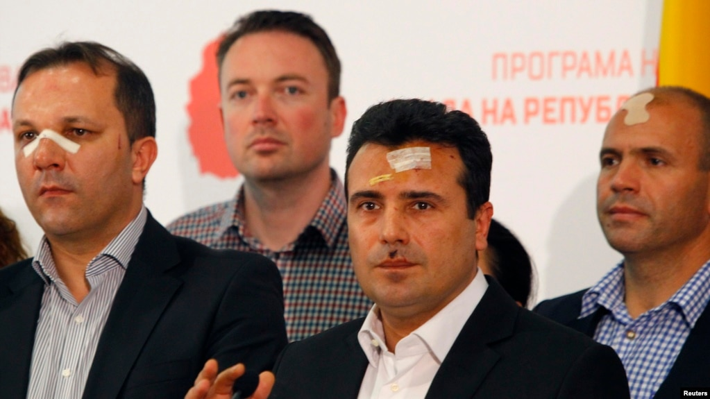 Macedonian Social Democratic leader Zoran Zaev (second from right) and other members of his party injured in the April 27 violence speak to reporters in Skopje on April 28.