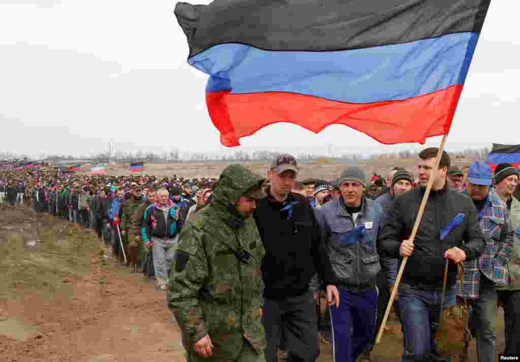 "Reservists of the self-proclaimed ""Donetsk People's Republic"" army attend a gathering at a military training ground near the town of Shakhtarsk on April 6. (Reuters/Aleksandr Ermochenko)"