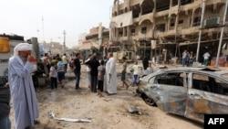 Pamje pas një eksplodimi të mëparshëm në Bagdad të Irakut