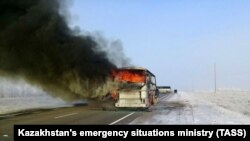 KAZAKHSTAN -- A view shows a burning bus on a route used by migrant workers heading to Russia, in the Aqtobe region, January 18, 2018