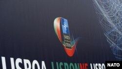 Логотип саммита НАТО в Лиссабоне