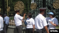 The four activists being arrested in Bishkek.