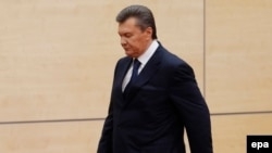Russia -- Ousted Ukrainian President Viktor Yanukovych arrives at a press conference in Rostov-na-Donu, February 28, 2014