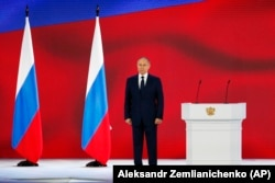 Russian President Vladimir Putin listens to the national anthem after his annual state-of-the-nation address in Moscow on April 21.