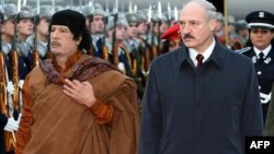Belarusian President Alyaksandr Lukashenka (right) and Muammar Qaddafi during a 2008 visit by the Libyan leader to Minsk. The EU is unlikely to add Belarusian economic entities to its sanctions list, as it did with Libya.