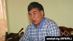 Кушбак Тезекбаев.
