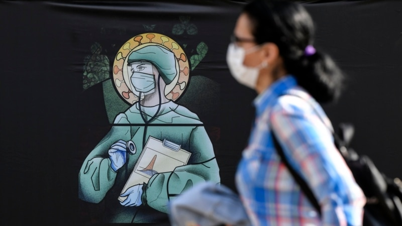 Posters Depicting Medical Workers As Saints Insult Christian Iconography, Romanian Orthodox Church Says photo