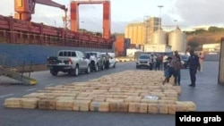 A photo purportedly shows stacks of cocaine seized from a ship docked in Cape Verde.
