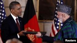 Президент США Барак Обама під час зустрічі з президентом Афганістану Хамідом Карзаєм у Кабулі, 2 травня 2012 року