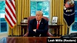 Президент США Дональд Трамп реагирует на вопрос. Белый дом, Вашингтон.