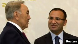 Kazakhstan -- Kazakhstan's President Nursultan Nazarbayev (L) meets Turkey's Deputy Prime Minister Bekir Bozdag during the first summit of the Cooperation Council of Turkic Speaking States (CCTS) in Almaty, 21Oct2011