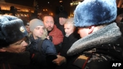 Russian police arrest opposition leader Eduard Limonov (second from right) during a protest in central Moscow on December 31.