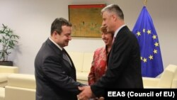 Kosovar Prime Minister Hashim Thaci, EU High Representative Catherine Ashton, and Serbian Prime Minister Ivica Dacic (right to left) in Brussels on May 21