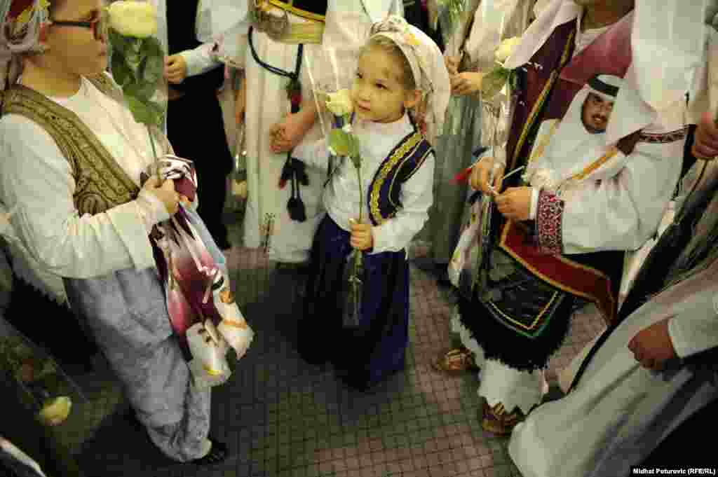 Bosnian schoolchildren attend the opening ceremony.