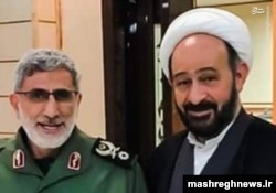 A handout photo released by Mashreghnews (a news website close to IRGC) shows new commander of IRGC's Qods Force Esmail Qaani (L) and Lebanese Shiite cleric Muhammad Kawtharani, who has long spearheaded Hezbollah's Iraq policy, undated.