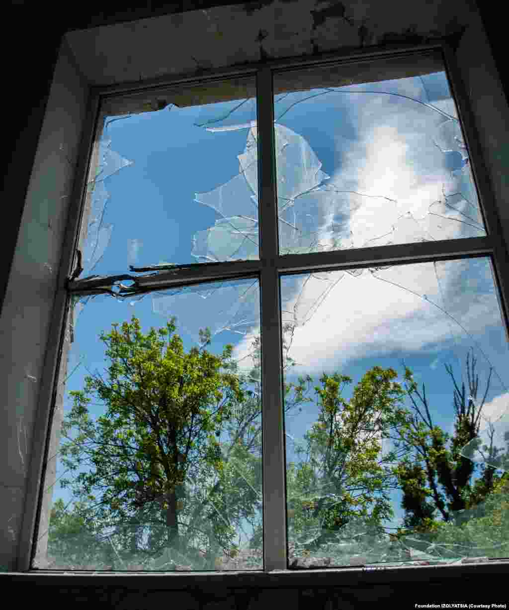 A window shattered by fighting