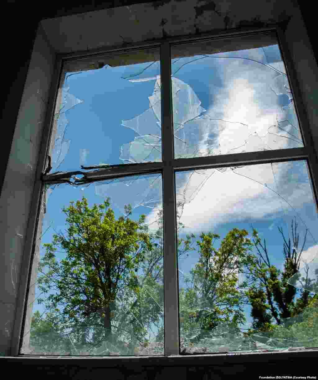 Окно после обстрела.