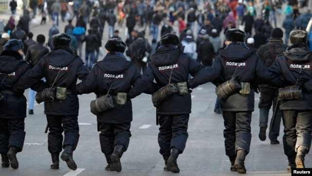 Russian police officers in a show of force on October 15.