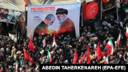 Thousands of Iranians on January 6 attend the funeral of Quds Force commander Qasem Soleimani, who was killed by a U.S. air strike.
