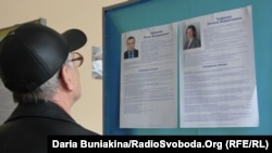 A voter in Cherkassy checks the candidate list.