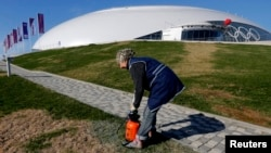 Days before the Winter Olympics open on February 7, many facilities in the Russian host city of Sochi remain unfinished. Workers are under pressure to clear construction rubble, pave streets, and even hydroseed yellowing grass before the games begin.