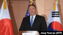U.S. Secretary of State Mike Pompeo speaks during a joint press conference with his Japanese and South Korean opposite numbers at the Foreign Ministry in Seoul on June 14.