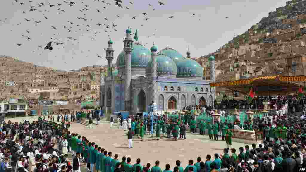 People gather for a New Year's ceremony at the Sakhi Shrine in Kabul in March.