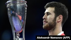 Russia's Karen Khachanov scored an upset victory over Serbia's Novak Djokovic to win the Paris Masters tennis title.