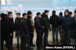 A polling station in Tashkent was quiet until this group of men arrived.