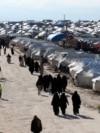 Women walk at al-Hol displacement camp in Hasaka governorate, Syria April 1, 2019. Picture taken April 1, 2019.