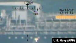 AT SEA -- This image released on June 17, 2019 by the U.S. Department of Defense in a press release is presented as a new evidence incriminating Iran in the June 13 tanker attacks in the Gulf of Oman