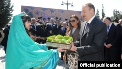 Azerbaijani President Ilham Aliyev and his wife Mehriban Aliyeva attend Norouz festivities in Baku on March 20.