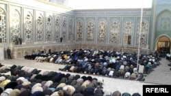 Tajik Muslims pray in the central mosque of Dushanbe