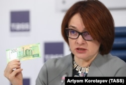 Russian Central Bank Governor Elvira Nabiullina presents the new 200 ruble banknote in Moscow on October 12.