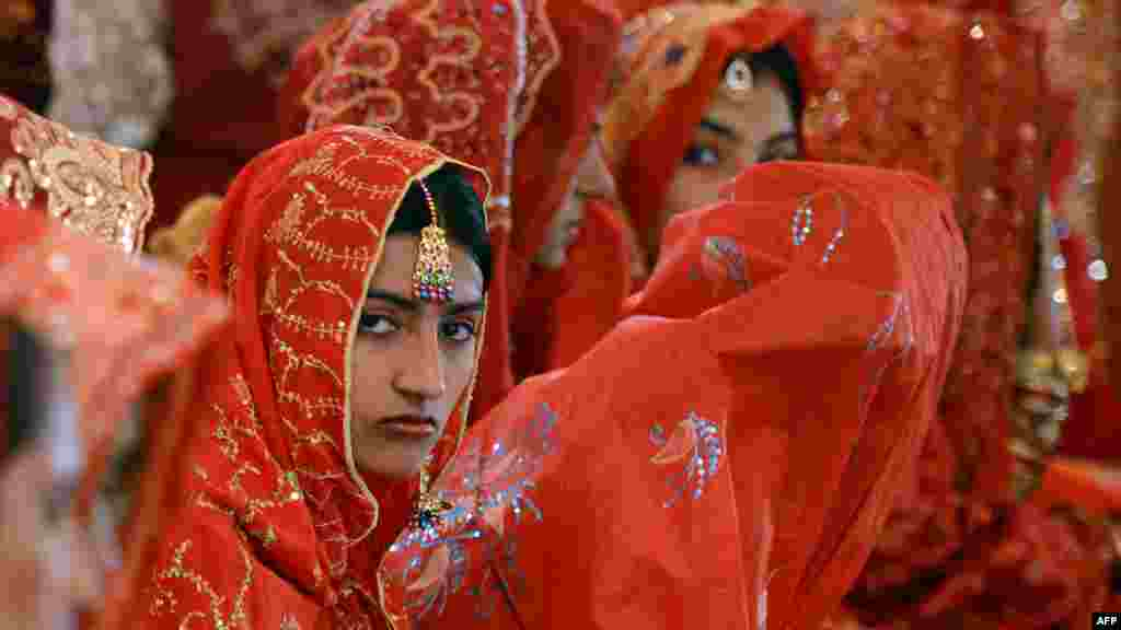 Pakistani brides attend a mass marriage ceremony in Karachi. Some 110 couples participated in the mass wedding ceremony organized by a local charity welfare trust. (AFP/Asif Hassan)