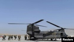 U.S. soldiers board a military Chinook helicopter similar to the one that went down in Maidan Wardak, west of Kabul, on August 5 or 6.