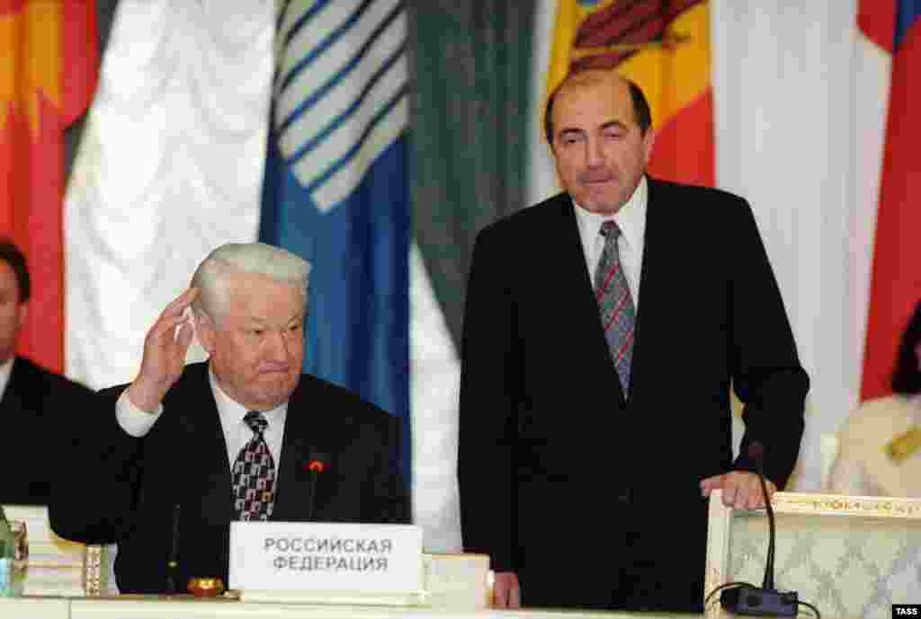 Then-Russian President Boris Yeltsin (left) with CIS Executive Secretary Boris Berezovsky at a CIS summit in Moscow on April 29, 1998.