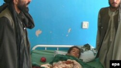 An Afghan boy injured in an alleged international air strike that hit a wedding ceremony in 2008 receives medical treatment at a hospital in Kandahar.