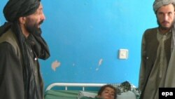 An Afghan boy believed to have been injured in a coalition air strike receives medical attention at a Kandahar hospital.