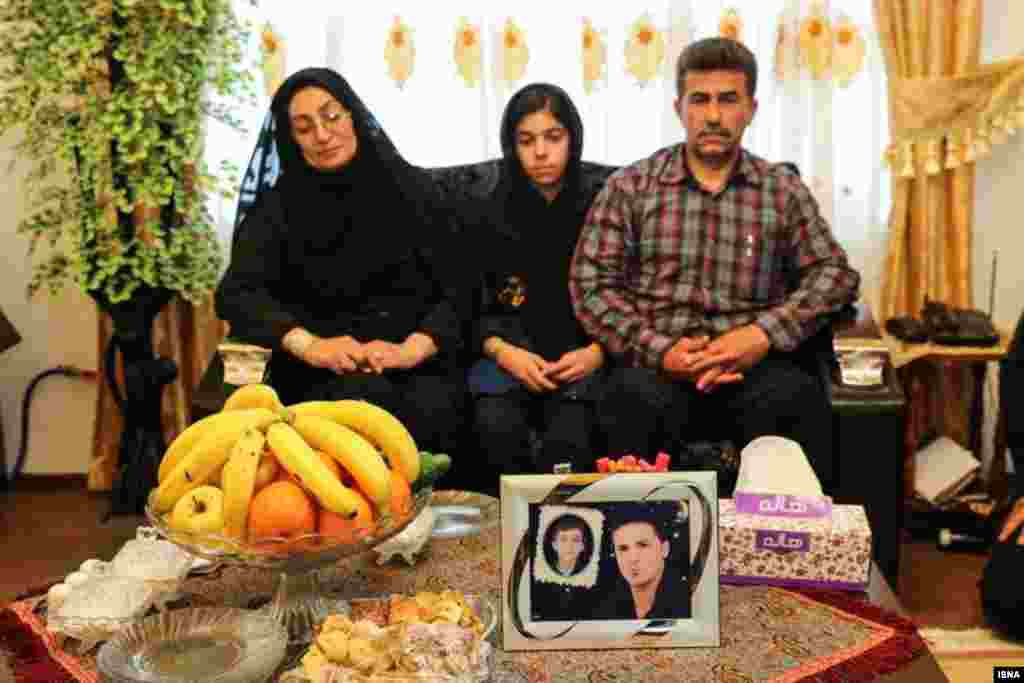 The parents and sister of the victim, Abdollah Hosseinzadeh, at their home. The family had lost another member, their 11-year-old son, in a motorbike accident.