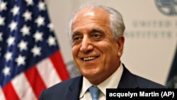 Special Representative for Afghanistan Reconciliation Zalmay Khalilzad approaches the microphone to speak on the prospects for peace at the U.S. Institute of Peace, in Washington on February 8.