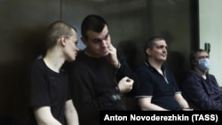 Left to right: Vyacheslav Kryukov, Ruslan Kostylenkov, Pyotr Karamzin and Dmitry Poletayev, members of the New Greatness youth activist group, attend a court hearing in Moscow on July 14.